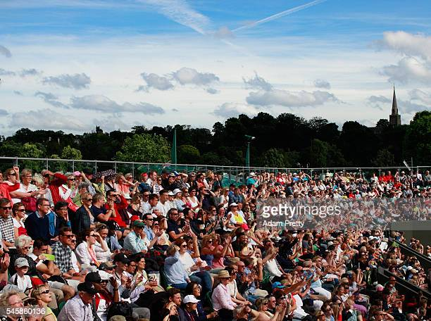 A general view as the crowd watch on court three on day thirteen of the Wimbledon Lawn Tennis Championships at the All England Lawn Tennis and...