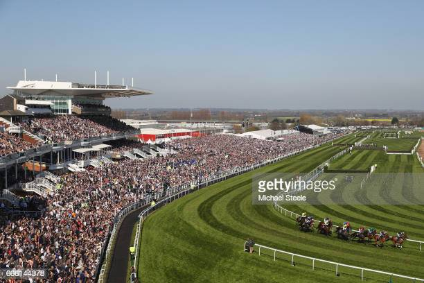 General view as the field heads past the grandstand in the Betway Novices' Hurdle Race during day three of the Randox Health Grand National meeting...