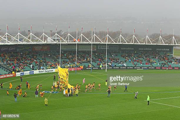A general view as the Hawks run through their banner during the round 15 AFL match between the Hawthorn Hawks and the Gold Coast Suns at Aurora...
