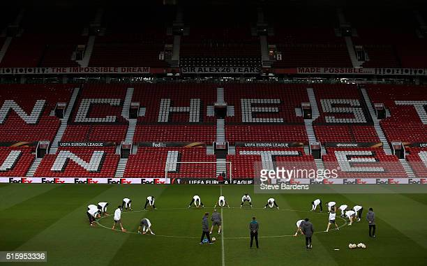 A general view as the Liverpool players warm up during a training session ahead of the UEFA Europa League round of 16 second leg match between...