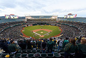 General view as the Oakland Athletics and Texas Rangers stand for the National Anthem before the start of the game on Opening Day at Oco Coliseum on...