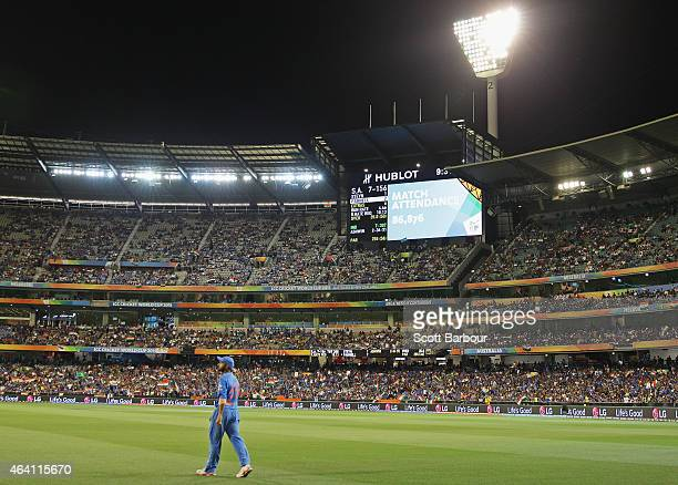 A general view as the official match attendance of 86876 is displayed on the scoreboard during the 2015 ICC Cricket World Cup match between South...