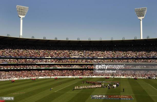 A general view as the players line up for the ANZAC Day ceremonies during the round five AFL ANZAC Day match between the Essendon Bombers and the...