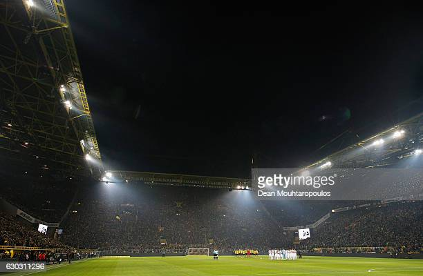 A general view as the players observe a minute's silence to remember the victims of the Berlin attack prior to the Bundesliga match between Borussia...
