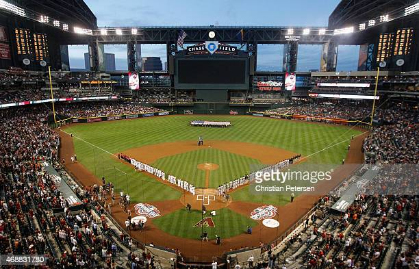 General view as the San Francisco Giants and the Arizona Diamondbacks stand attended for the national anthem before the Opening Day MLB game at Chase...