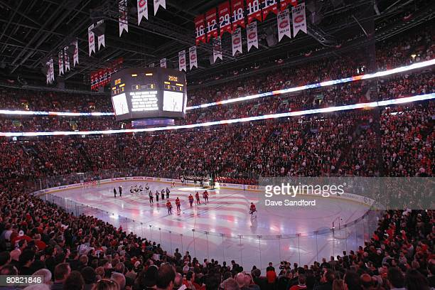 General view as the starting lineups for the Montreal Canadiens and the Boston Bruins stand for the singing of the national anthems at the start of...