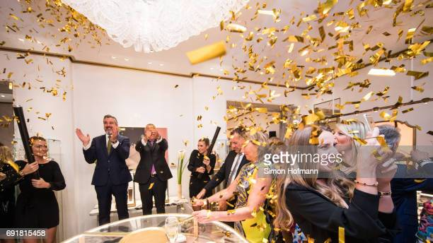 A general view as the store is opened with a confetti shower by Deniz Imdat Store Manager and JeanChristophe Babin CEO of Bulgari during the Bulgari...