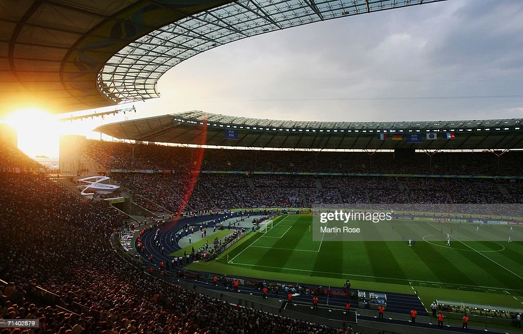 General view as the sun dips behind the stand during the FIFA World Cup Germany 2006 Final match between Italy and France at the Olympic Stadium on...