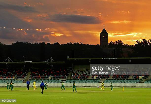 A general view as the sun sets during the women's one day international match between the Australian Southern Stars and South Africa at Manuka Oval...