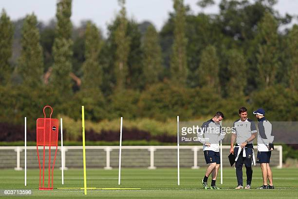 A general view as the Tottenham Hotspur Coaching staff are in conversation during the Tottenham Hotspur training session at Tottenham Hotspur...