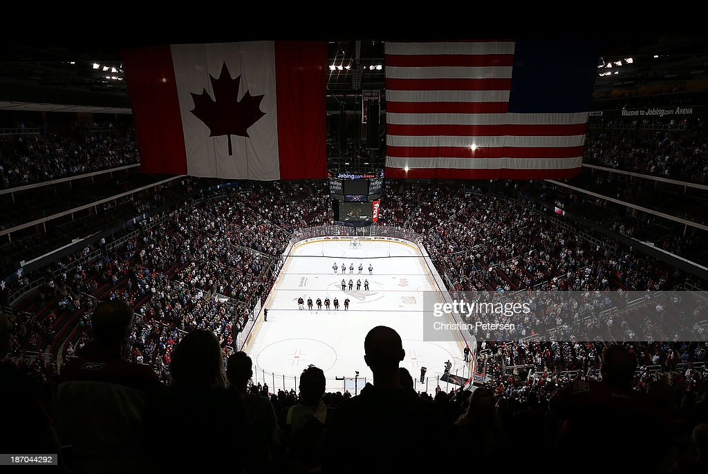 General view as the Vancouver Canucks and the Phoenix Coyotes stand attended for the National Anthem before the NHL game at Jobing.com Arena on November 5, 2013 in Glendale, Arizona.