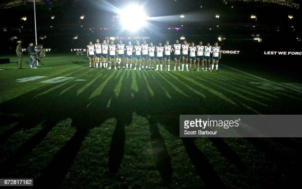A general view as the Warriors stand for the playing of The Last Post during the round eight NRL Anzac Day match between the Melbourne Storm and the...
