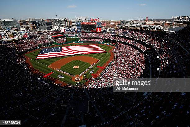 General view as the Washington Nationals and New York Mets line the field during the National Anthem before the start of Opening Day at Nationals...