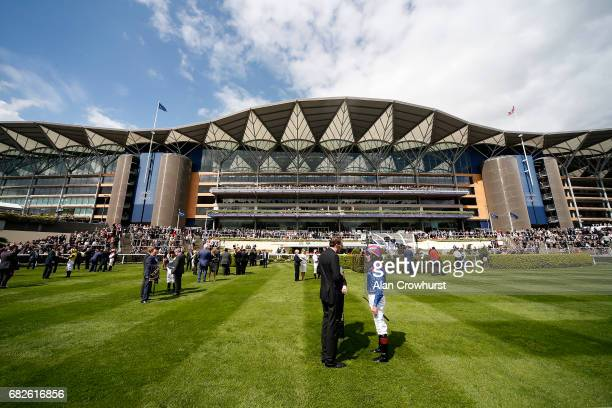 A general view as trainer James Fanshawe chats with jockey Tom Queally at Ascot Racecourse on May 13 2017 in Ascot England