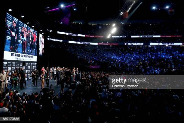 A general view as UFC lightweight champion Conor McGregor poses on the scale during his official weighin at TMobile Arena on August 25 2017 in Las...