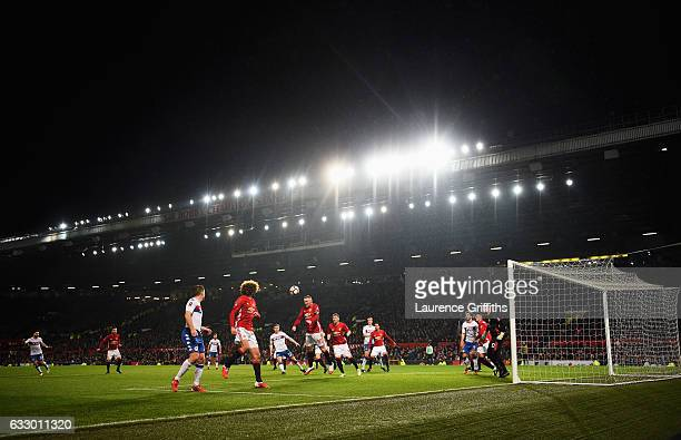 A general view as Wayne Rooney of Manchester United heads the ball during the Emirates FA Cup Fourth round match between Manchester United and Wigan...