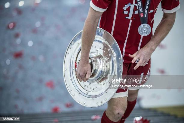 A general view as Xabi Alonso of Muenchen carries the trophy after the Bundesliga match between Bayern Muenchen and SC Freiburg at Allianz Arena on...