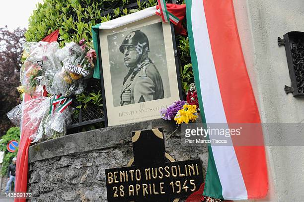 A general view at commemoration ceremony for the death of Italian dictator Benito Mussolini and his mistress Claretta Petacci in front of a headstone...