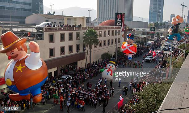 General view during a Christmas parade in Monterrey Nuevo Leon state Mexico on December 8 2013 AFP PHOTO/Julio Cesar AGUILAR
