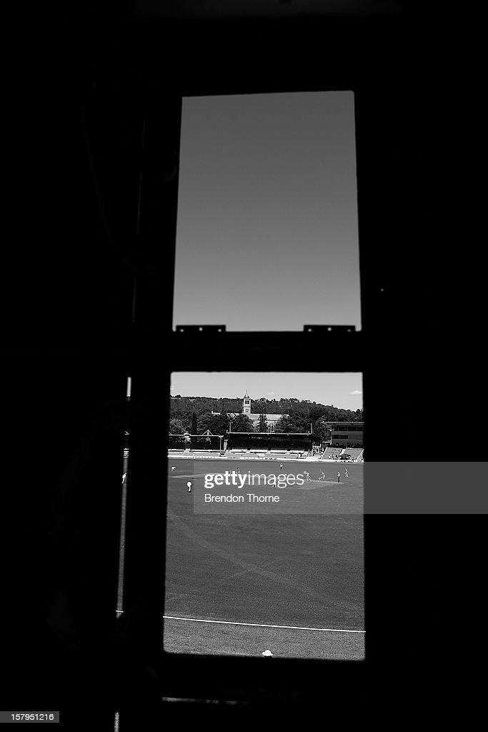 A general view during an international tour match between the Chairman's XI and Sri Lanka from inside The Jack Fingleton Scoreboard at Manuka Oval on December 8, 2012 in Canberra, Australia. The Jack Fingleton Scoreboard was first erected at the MCG in 1901. In 1982 it was replaced by an electronic board and donated to the Manuka Oval by the Melbourne Cricket Club as memorial to J.H.W Fingleton OBE.