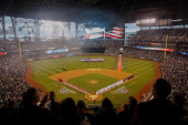 A general view during the national anthem prior to the game between the Los Angeles Angels of Anaheim and the Seattle Mariners on Opening Day at...