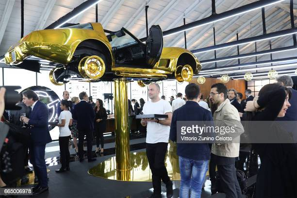 A general view during the Precious Garage installation designed for Cartier on April 5 2017 in Milan Italy
