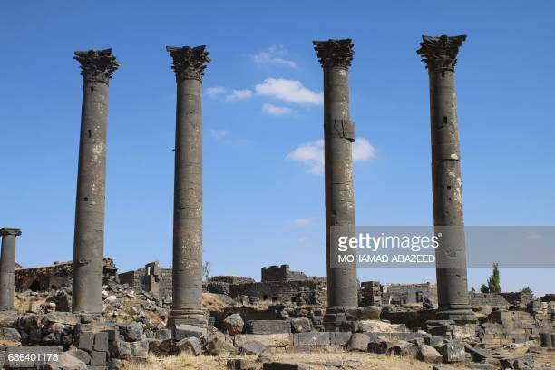 A general view four columns know as the Cardos Maximus that were damaged in shelling in 2015 in the ancient city of Bosra alSham a UNESCO World...