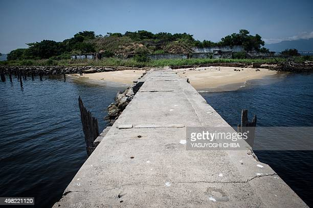 General view from a pier of the Ilha Seca island at Guanabara Bay in Rio de Janeiro Brazil on November 13 2015 Ilha Seca a Texaco fuel depot...