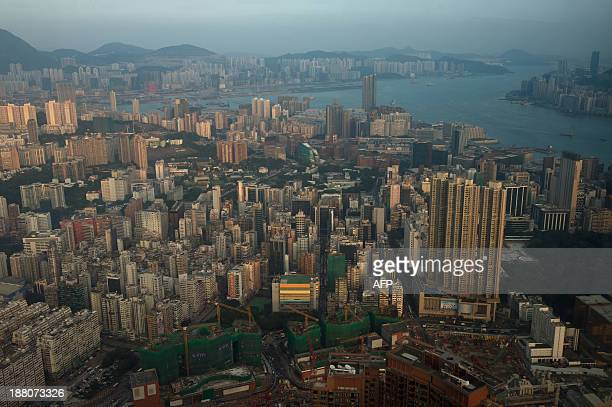 A general view from an observation deck in Kowloon shows high rise buildings and construction work and buildings on Hong Kong island on November 15...