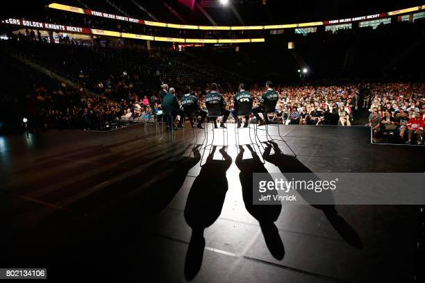 A general view from backstage is seen of MarcAndre Fleury Deryk Engelland Brayden McNabb and Jason Garrison speaking onstage during the Vegas Golden...