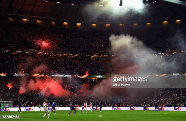 A general view from inside the stadium as a flare is set off within supporters during the UEFA Europa League Final between Ajax and Manchester United...