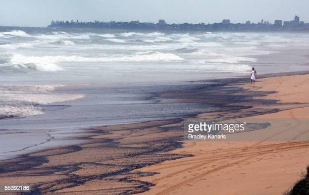 A general view from Kawana Beach is seen amongst the oil slick which escaped from the container ship 'Pacific Adventurer' during this week's Cyclone...