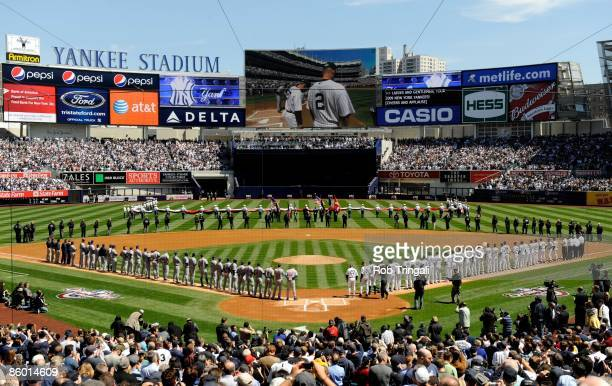 A general view from overhead of the interior of Yankee Stadium during the National Anthem on Opening Day game between the New York Yankees and the...