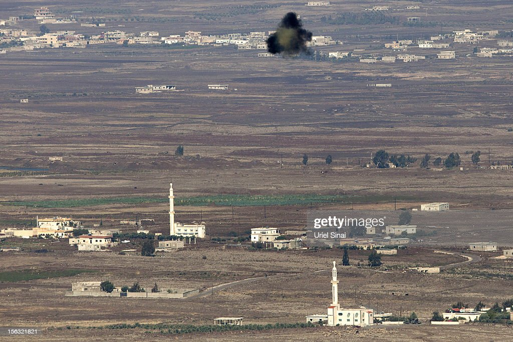 A general view from the Israeli-annexed Golan Heights of a mid-air shell explosion near the Syrian village of Breqa on November 13, 2012 near Alonei Habashan in the Golan Heights. Tension remains high in the disputed Golan Heights after Israeli Defence Forces retaliated after mortar shells were fired into Israeli territory from Syria.