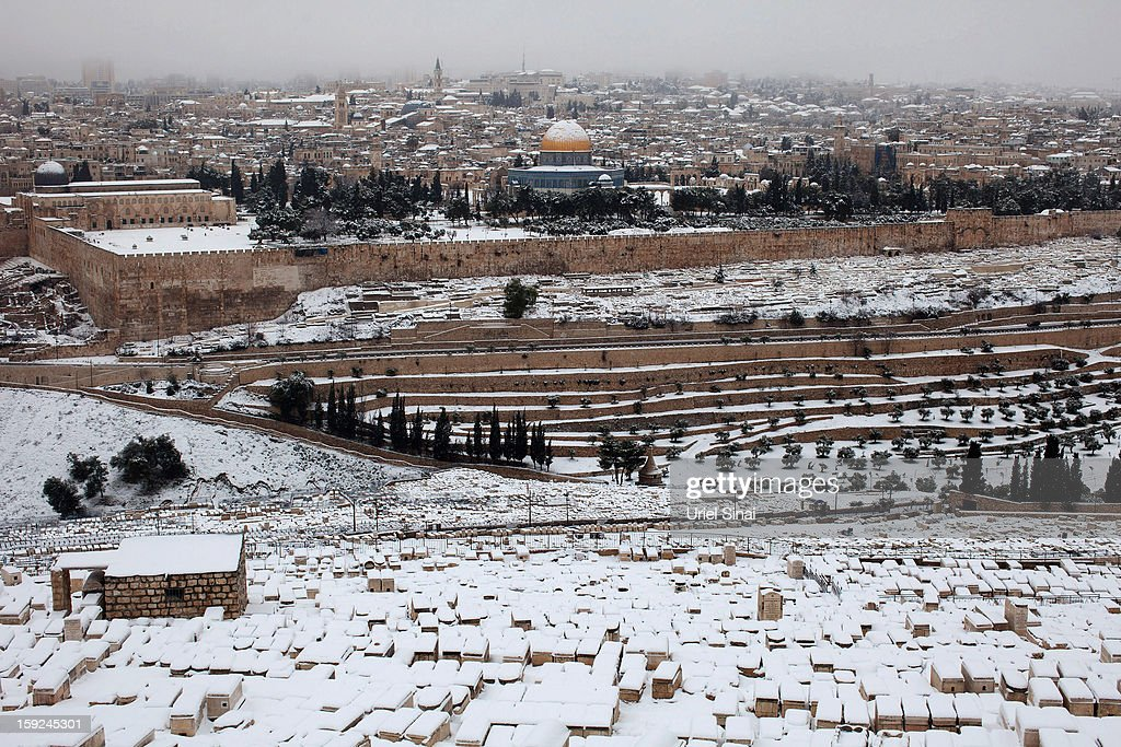 A general view from the Jewish cemetery at the Mount of Olives shows the snow-covered old city of Jerusalem on January 10, 2013 in Jerusalem, Israel.