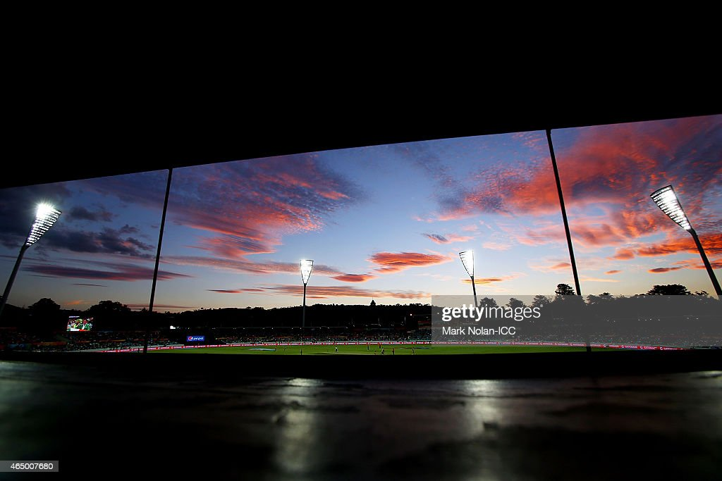A general view from the scoreboard as the sun sets over the ground during the 2015 ICC Cricket World Cup match between South Africa and Ireland at Manuka Oval on March 3, 2015 in Canberra, Australia.