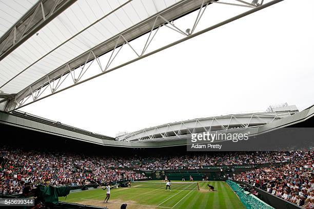 A general view inside Centre court as Venus Williams of The United States serves during the Ladies Doubles Final against Timea Babos of Hungary and...