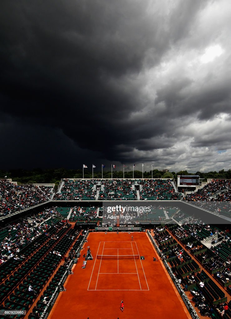 A general view inside Court Philippe Chatrier as coulds begin to form during the ladies singles Quarter Finals match between Kristina Mladenovic of France and Timea Bacsinszky of Switzerland on day ten of the 2017 French Open at Roland Garros on June 6, 2017 in Paris, France.