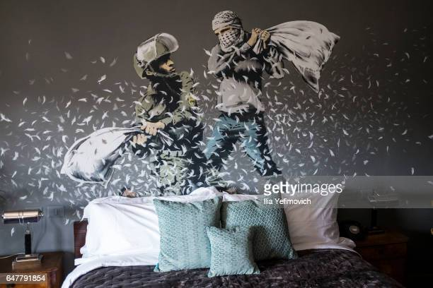 A general view inside street artist Banksy's newly opened Walled Off Hotel in the Israeli occupied West Bank town of Bethlehem on March 4 2017 in...