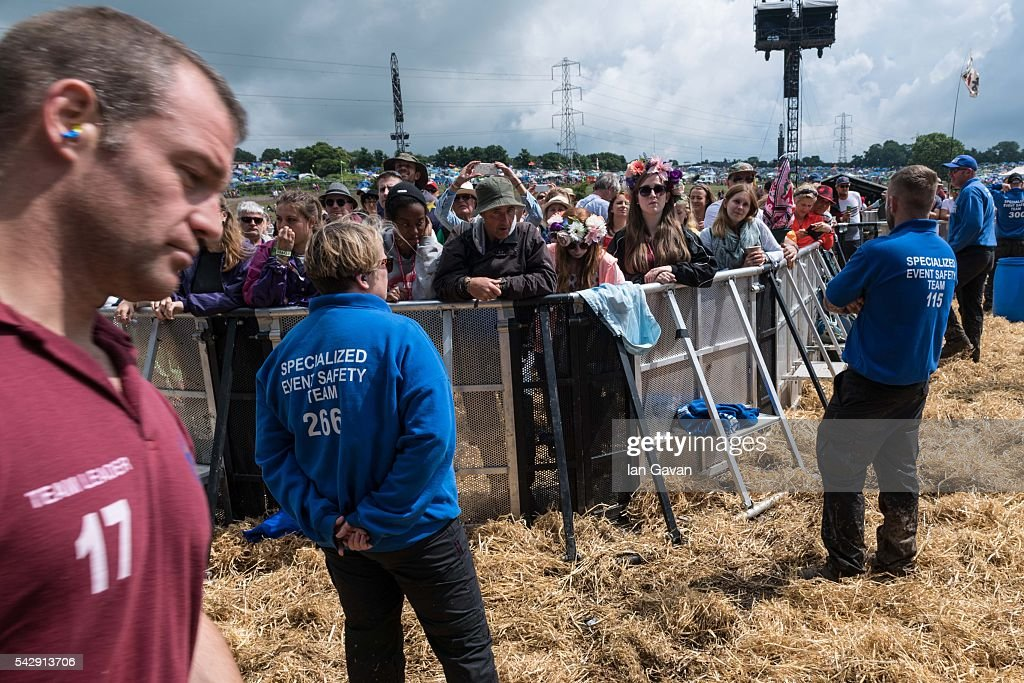 General view inside the photo pit as The Lewisham and Greenwich NHS Choir perform on the Pyramid Stage on day 2 of the Glastonbury Festival at Worthy Farm, Pilton on June 25, 2016 in Glastonbury, England. Now in its 46th year the festival is one largest music festivals in the world and this year features headline acts Muse, Adele and Coldplay. The Festival, which Michael Eavis started in 1970 when several hundred hippies paid just £1, now attracts more than 175,000 people.