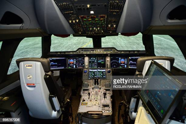 A general view inside the simulator of the A350 XWB cockpit is seen during a tour of the Airbus Asia Training Centre in Singapore on June 20 2017...