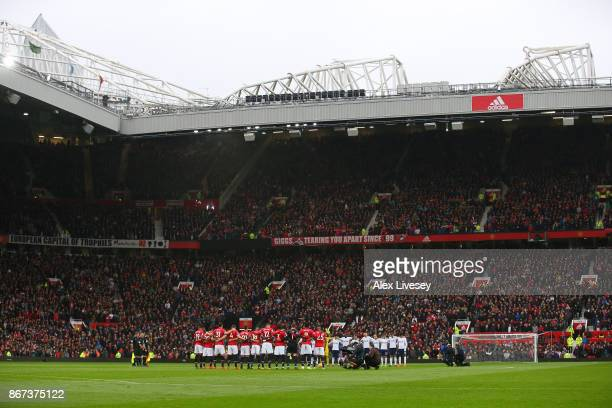 General view inside the stadium as a minute of silence is held to remeber those who have died in conflict prior to the Premier League match between...