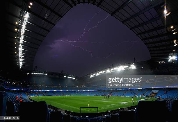 A general view inside the stadium as Lightning strikes following the postponement of the UEFA Champions League Group A match between Manchester City...