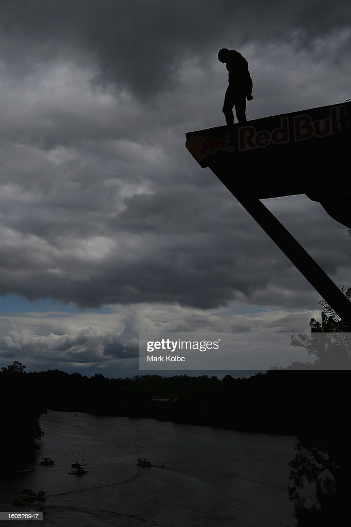 A general view is seen as a competitor prepares to dive during the Red Bull Cliff Diving qualifying round in the Hawkesbury River on February 2, 2013 in Sydney, Australia.