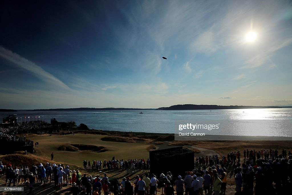 A general view is seen as fans watch play on the 17th green during the third round of the 115th US Open Championship at Chambers Bay on June 20 2015...