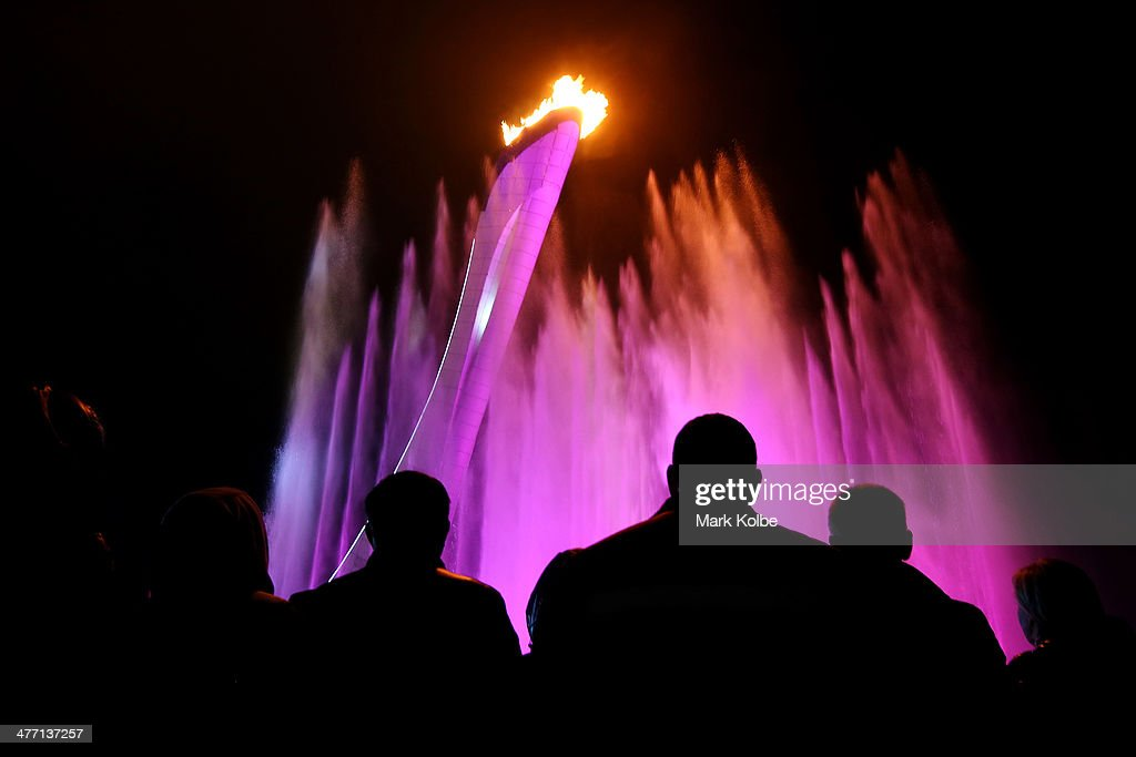 A general view is seen as spectators watch a water and light show in front of the flame after its lighting outside Fisht Olympic Stadium during the Opening Ceremony of the Sochi 2014 Paralympic Winter Games at Fisht Olympic Stadium on March 7, 2014 in Sochi, Russia.