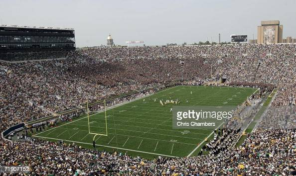 A general view is seen as the Michigan Wolverines run an offensive play against the defense of the Notre Dame Fighting Irish September 16 2006 at...