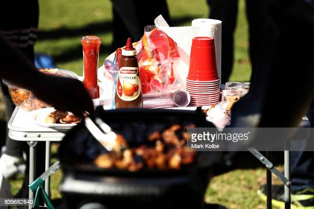 A general view is seen of a tailgate BBQ in the Moore Park carpark before the College Football Sydney Cup match between Stanford University and Rice...