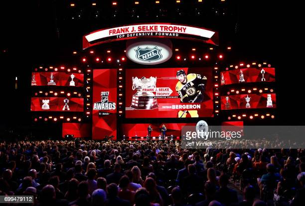 A general view is seen of Patrice Bergeron of the Boston Bruins speaking onstage to receive the Frank J Selke Trophy during the 2017 NHL Awards...