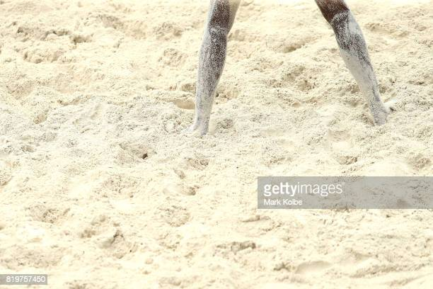 A general view is seen of sand stuck to a players legs during the Boys Beach Volleyball on day 3 of the 2017 Youth Commonwealth Games at Queen...